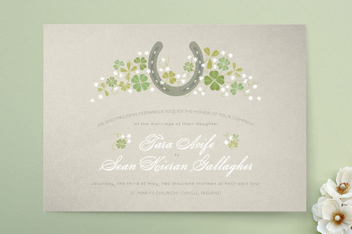 A lucky horseshoe surrounded by sweet white wildflowers and green shamrocks, will certainly bring more than bit of luck to your wedding ceremony. From Minted.