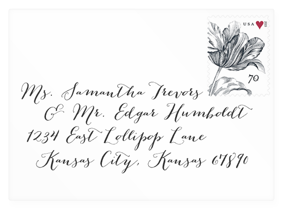 Calligraphy addressed wedding envelope mock-up with Bombshell Pro font (link to download).